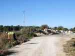 Ruta ciclista entre escombros en el Hoyo Serrano